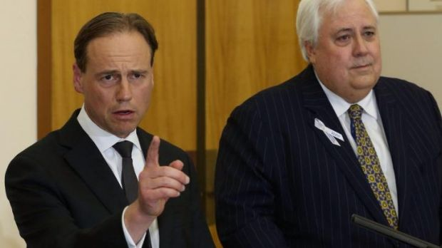 Greg Hunt and Clive Palmer address the media on Wednesday.