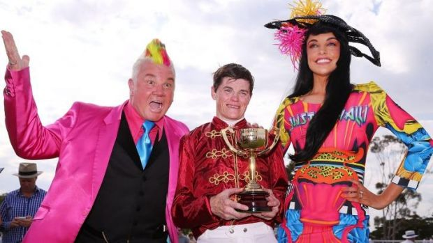 City of Greater Geelong Mayor, Cr Darryn Lyons and his fiancee Elissa Friday congratulate winning jockey Craig Williams ...