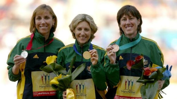Australia's Krishna Stanton, Kerryn McCann and Jackie Gallagher hold their medals after winning gold, silver and bronze ...