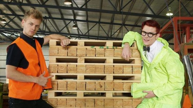 Comedians Joel Creasey (left) and Rhys Nicholson show they know how to do some manual work in a timber yard in the ...