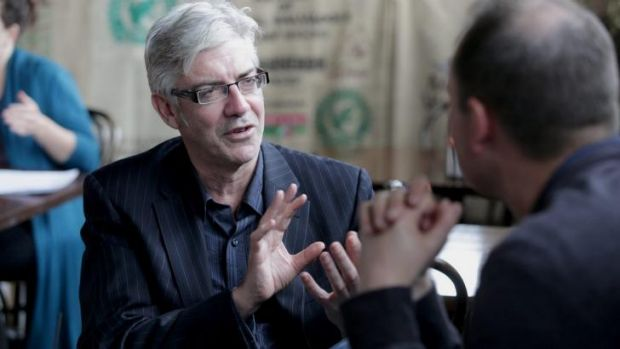 Efficient eating: Writer, actor and comedian Shaun Micallef at the Goat House Cafe Roastery in Elsternwick.