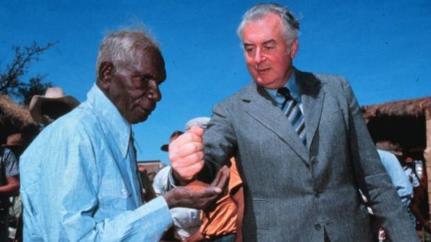 PM Gough Whitlam pours sand into the hand of Vincent Lingiari in 1975. Lingiari's descendants will attend Wednesday's ...