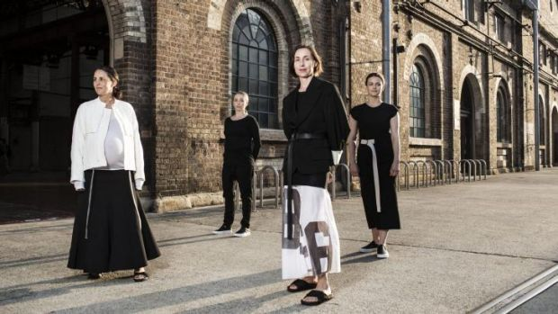 Designers Mary Lou Ryan and Deborah Sams, of Sydney's bassike, front, with Carriageworks staff in their new uniforms.