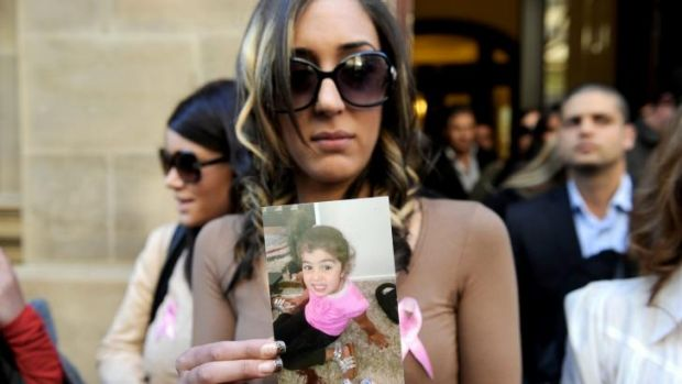 Rachelle D'Argent holds up a photo of her murdered daughter Yazmina in front of the Supreme Court.