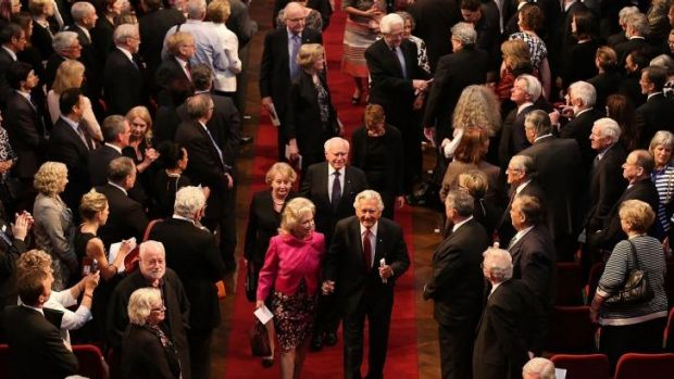 Former Australian prime ministers John Howard (back right) and Bob Hawke (front right) leave at the end of Gough ...