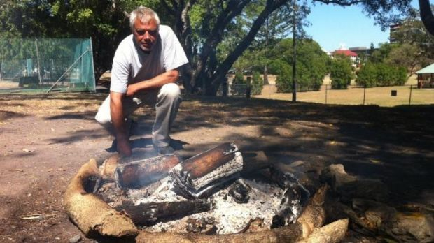 Jagera elder Kevin Vieritz at Musgrave Park's symbolic flame.