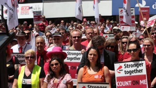 Seeing red: At a rally in Canberra a couple of thousand public servants turned up at lunchtime, many wearing red, to ...