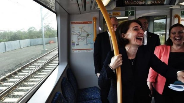 Light moment on new heavy rail: Transport Minister Gladys Berejiklian enjoys the journey.