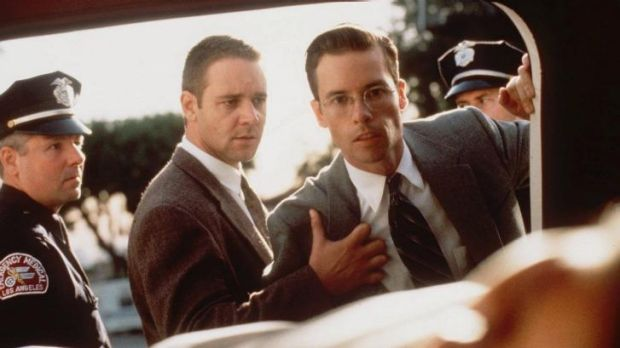 Mixed-up movie stars: Russell Crowe, second from left, and Guy Pearce playing Los Angeles police detectives in <i>L.A. ...