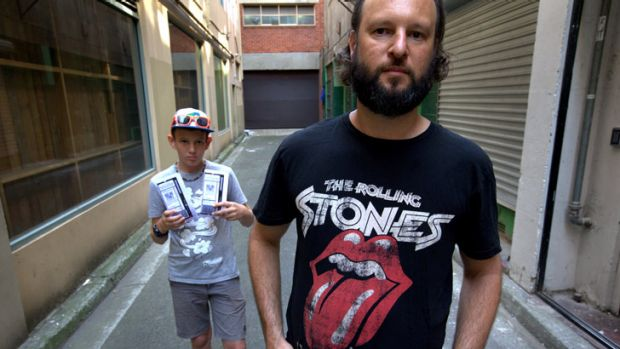 Justin Quintner, right, and his 13-year-old son Andre travelled from Darwin via Adelaide to see the Rolling Stones at ...