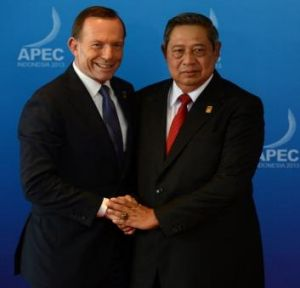 Australia's Prime Minister Tony Abbott is welcomed by Indonesia's President Susilo Bambang Yudhoyono at APEC in 2013.