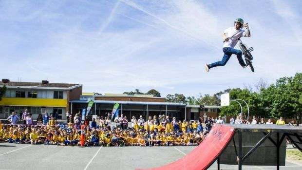 Arawang Primary School celebrate Ride or Walk to School day with Backbone BMX's Mike Ross.
