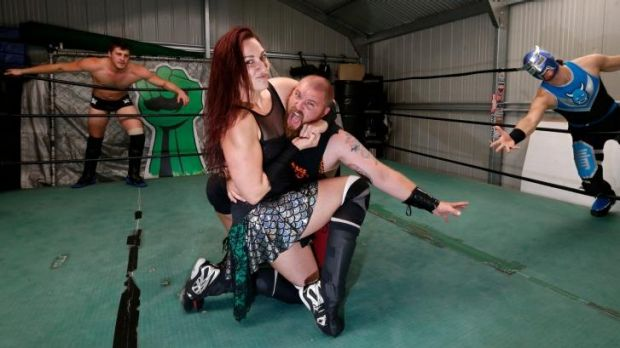 Power couple: Husband-and-wife team Ryan and Madison Eagles (centre) with fellow wrestlers Dan Wilson (left) and Blue Oni.