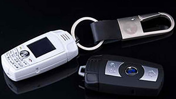 Deceptive: The BMW key-ring phones, sold for as little as $30 in China.