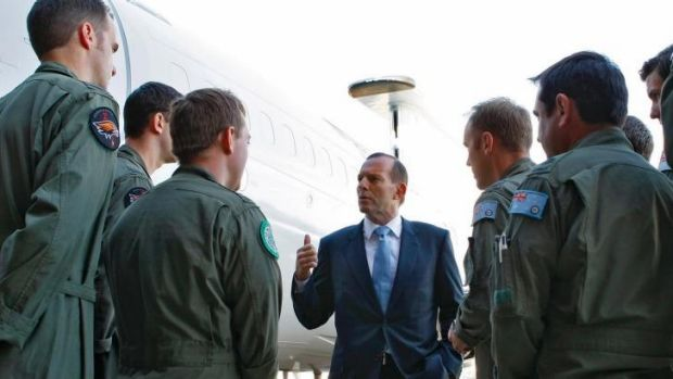 ''Flag patriot'' charge: Prime Minister Tony Abbott addresses troops at RAAF Base Williamtown.