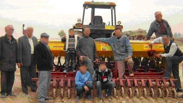Under Islamic State control: Some of the Iraqi farmers involved in the project, pictured in 2009.