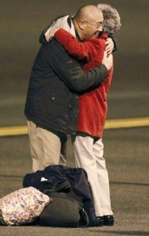 Kenneth Bae and his mother Myung Hee Bae embrace.