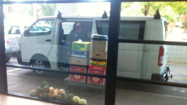Bad example: A fruit and vegetable distributor leaves food on the ground while making deliveries.