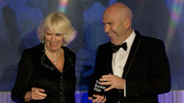 Richard Flanagan accepting the Man Booker literature prize from Camilla, Duchess of Cornwall.