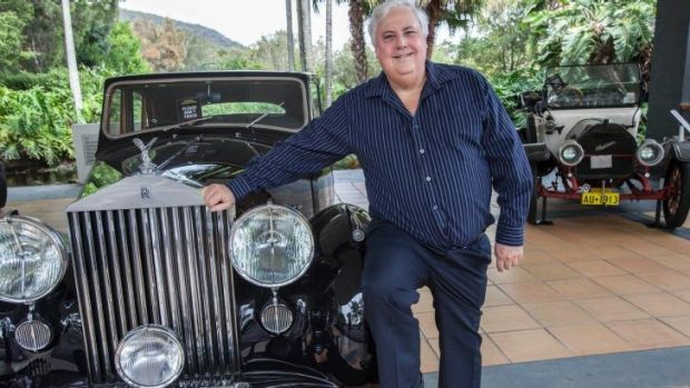 Playing the game: Clive Palmer, pictured with a car from his vast collection, had been driving through his electorate ...