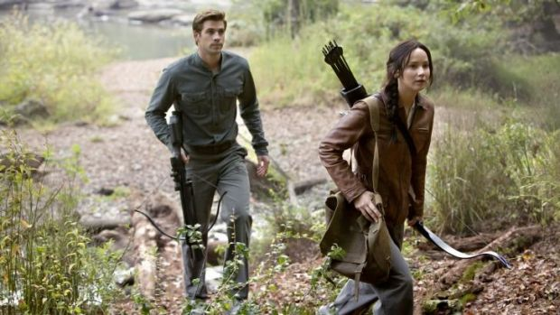 Back to the woods: Liam Hemsworth and Jennifer Lawrence in the latest instalment of <i>The Hunger Games</i>.