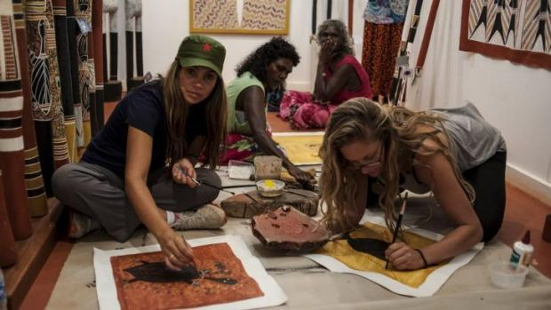"""Sandy, left, painting. She said on the show that Aboriginal people """"burn down"""" houses they are given and are mostly ..."""