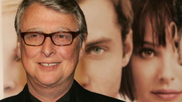 Mike Nichols stands in front of a poster for his 2004 film <i>Closer</i>.