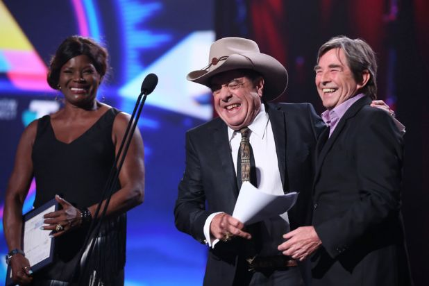 Marcia Hines and John Paul Young induct Molly Meldrum into the Hall of Fame.