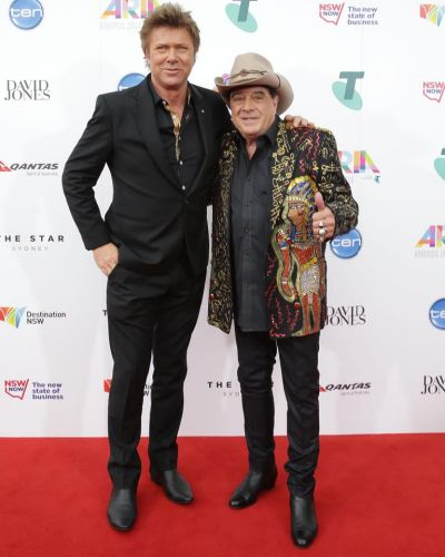 Richard Wilkins and Molly Meldrum arrive at the ARIA Awards 2014.