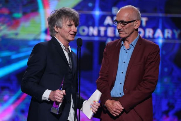 Neil Finn and Paul Kelly accept the ARIA for best adult contemporary album.