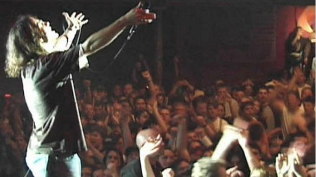 American hard rock band Creed in concert in 1999.
