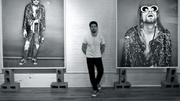 Photographer: Jesse Frohman with some of his portraits on display at Blender Gallery.