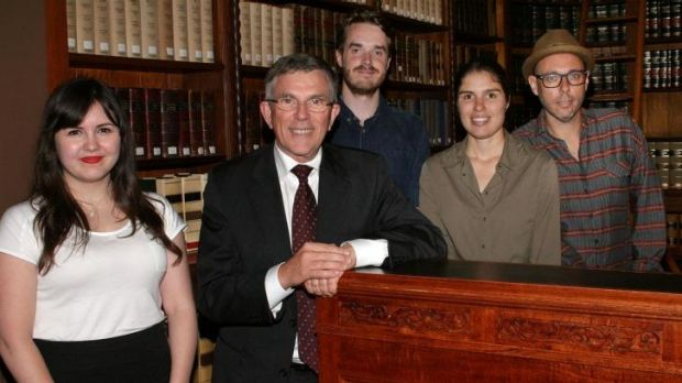Arts Minister Ian Walker (in suit) with Queensland Writers Fellowship winners Sophie Overett, Ellen van Neerven and ...