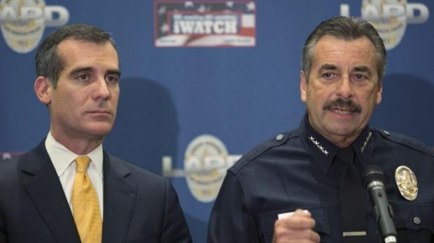 Los Angeles Police Chief Charlie Beck,right, addresses threats made by Sony Studios hackers.