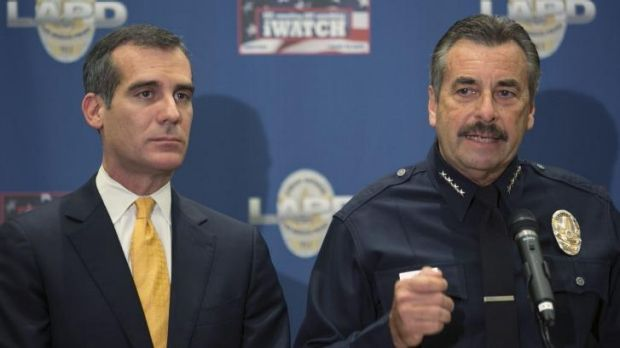 LA police chief Charlie Beck, right, comments on Sony Studios hackers' threats at a news conference.