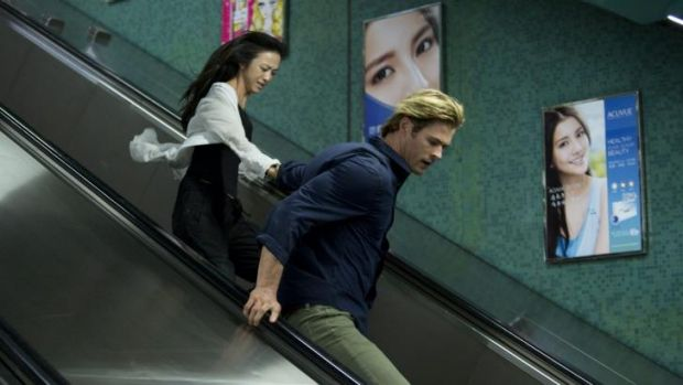 Irony: Wei Tang and Chris Hemsworth in Michael Mann's cyber-thriller <i>Blackhat</i> which opens in the US in mid-January.
