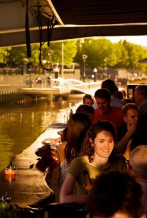 Mixers: Diners and drinkers at Ponyfish Island cafe on warm spring evening.
