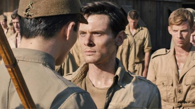 Repetitive cruelties: Jack O'Connell as Louis Zamperini in <i>Unbroken</i>.
