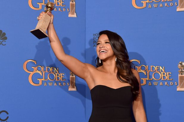 <i>Jane the Virgin</i> star Gina Rodriguez with the award for best actress in a TV series (comedy or musical).