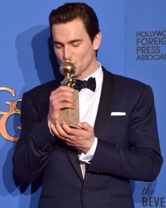 <i>The Normal Heart</i>'s Matt Bomer with the Golden Globe for best supporting actor in a TV movie or miniseries.