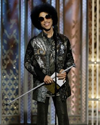 Prince presents the Golden Globe for best original song.