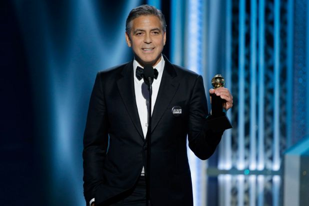 George Clooney accepts the honorary Cecil B. DeMille award.
