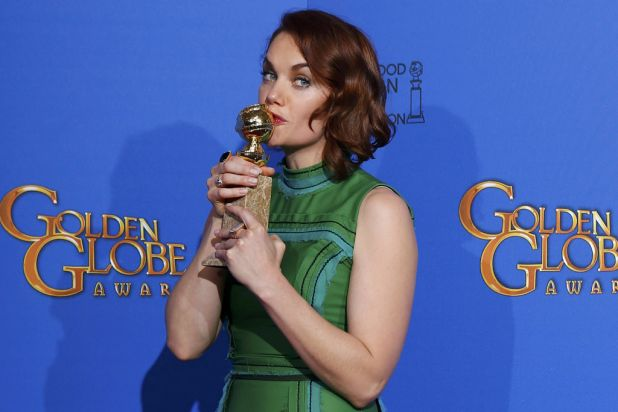 Ruth Wilson kisses her award for best actress in a TV series (drama) for <i>The Affair</i>.