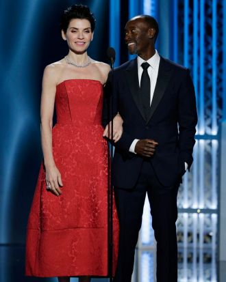 Julianna Margulies and Don Cheadle present the honorary Cecil B. DeMille award to George Clooney.