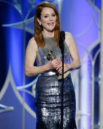 Julianne Moore accepts the Golden Globe for best actress in a motion picture (drama) for <i>Still Alice</i>.