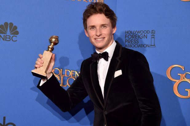 <i>The Theory of Everything</i>'s Eddie Redmayne with the Golden Globe for best actress in a motion picture (drama).