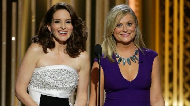 Golden Globes co-hosts Tina Fey, left, and Amy Poehler did not hold back in their final gags.