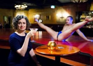Cheers? Judith Lucy investigates the meaning of being all woman.