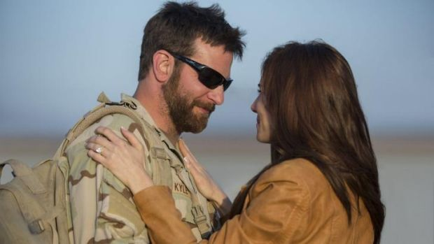 Screen couple: Bradley Cooper and Sienna Miller play Chris Kyle and his wife, Taya, in <i>American Sniper</I>.