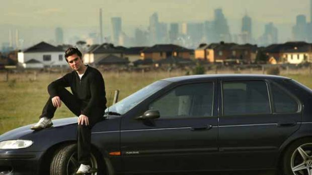 Martin Chiriano, of Werribee, and his old Falcon. Soaring petrol prices have hit hard.